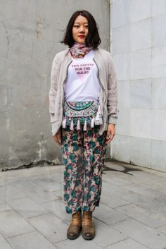 Styling by Mimi Berlin. Ray is wearing a t-shirt by Martin Butler. Jacket from COS, scarf, bag and floral pants from a local Beijing clothing store. Boots: model's own.