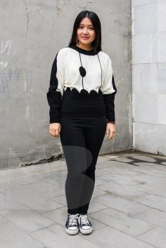 Paris is wearing a silk knitted top by Conny Groenewegen and her own skinny jeans