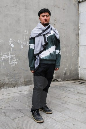 Greg is wearing a silk scarf by youasme-measyou, t-shirt, trousers and shoes: model's own.